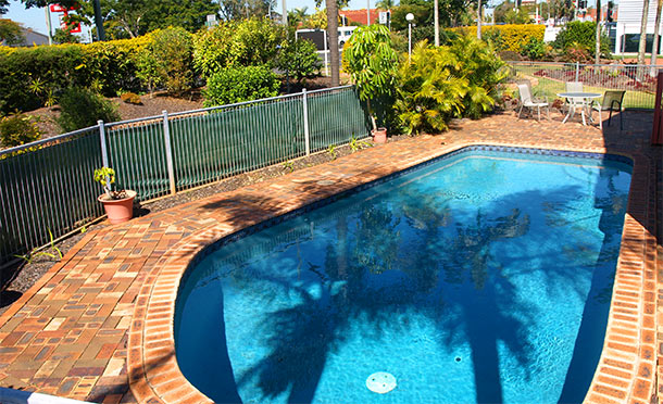 Swimming pool for guests at Lancaster Court Motel Annerley